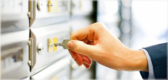Person unlocking a safety deposit box